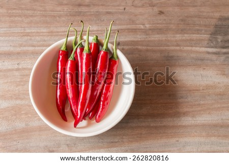 Red chilli on wood background - stock photo