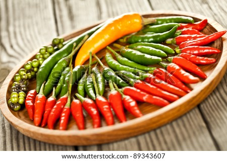 Red chilli peppers and other pepper - stock photo