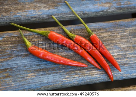Red  chillies  on wooden blue  table - stock photo