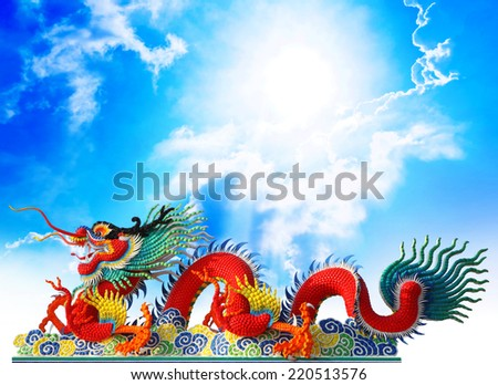 Red chinese dragon stucco arts with cloud and blue sky background, clipping path. - stock photo