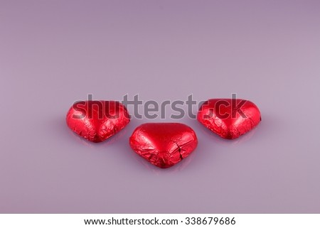 Red chocolate hearts candies - stock photo