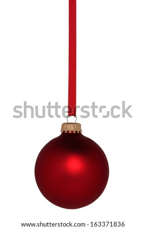 Red Christmas ball ornament hanging on red ribbon. - stock photo