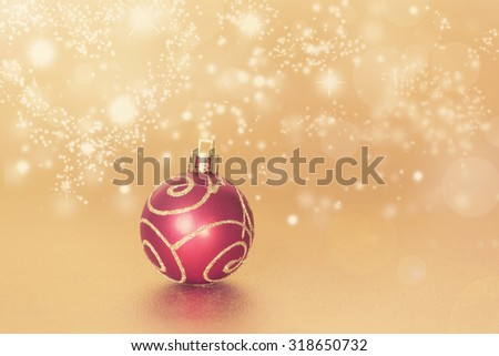 Red christmas ball with gold heart bokeh background,istagram filter,retro effect - stock photo