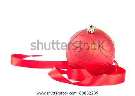 Red christmas ball with ribbon - stock photo