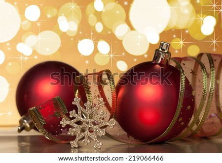 Red christmas ball with snowflake on Christmas light background