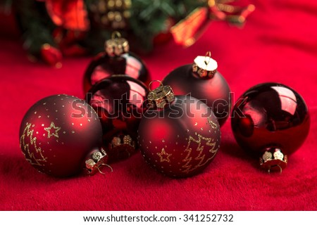 Red christmas balls on red background. - stock photo