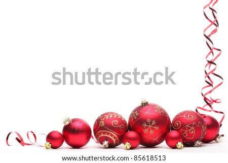Red Christmas balls with ribbons isolated on white. - stock photo