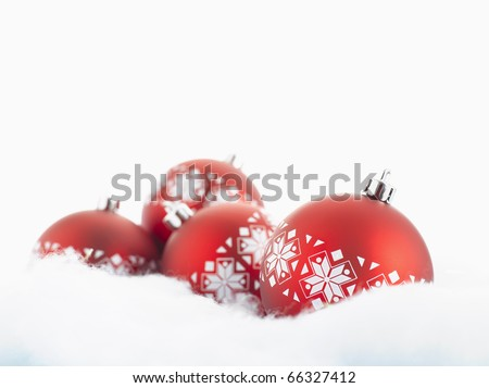Red christmas balls with snow isolated on white - stock photo