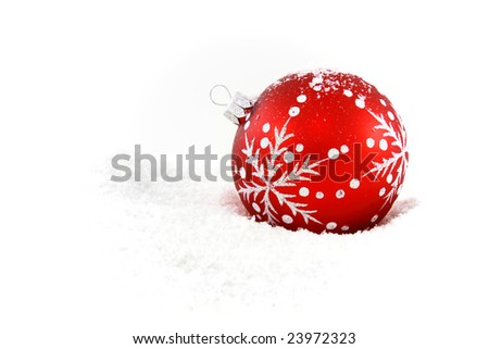 Red christmas bauble in fresh white snow - stock photo