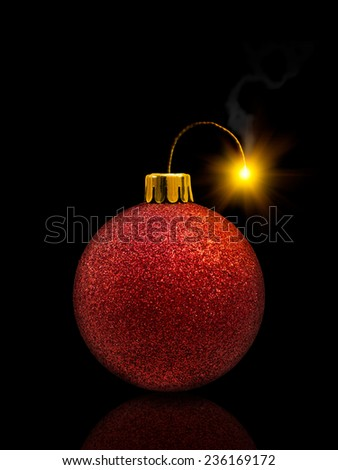 Red christmas bauble with burning fuse, fireworks concept - stock photo