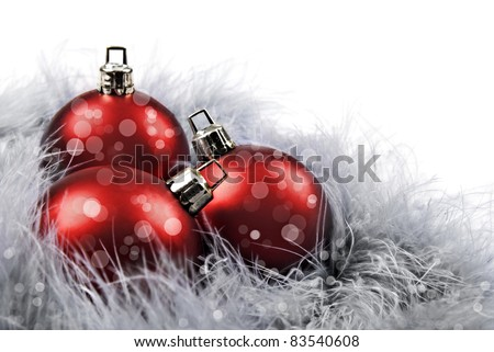 Red christmas baubles on a white background with space for text - stock photo