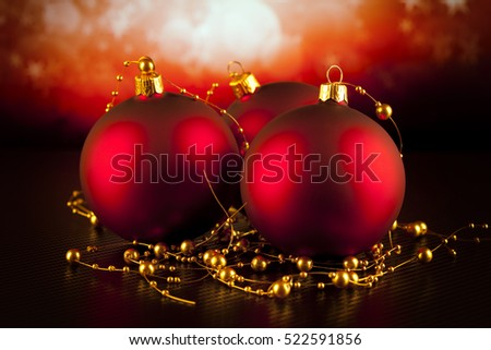 Red Christmas baubles on black table and red background