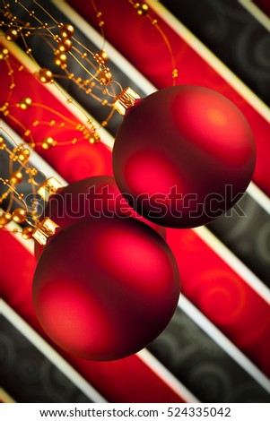 Red Christmas baubles on pattern background