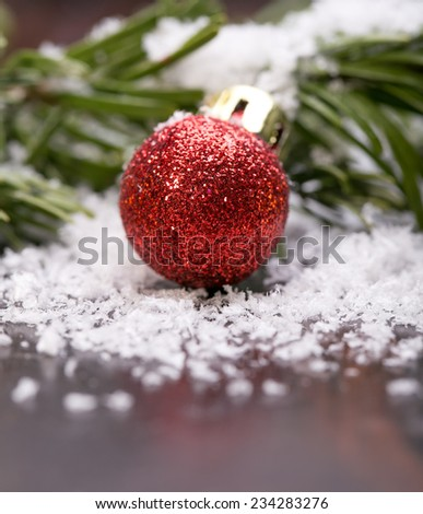 Red christmas baubles on the snow. christmas decorations