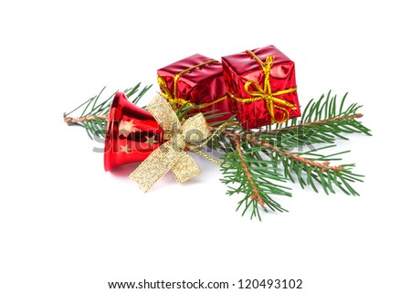 red christmas bell with fir branch on white