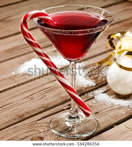 Red Christmas cocktail in martini glass - stock photo
