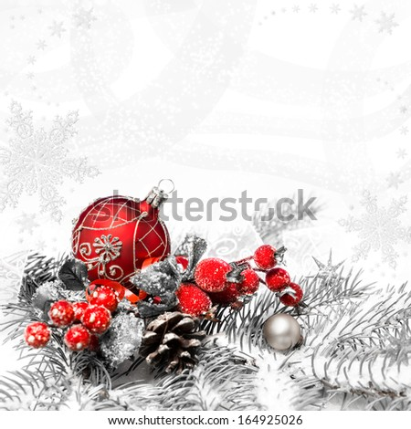 Red Christmas decorations on neutral winter background, text space - stock photo