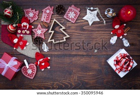 Red Christmas decorations on rustic wooden background - stock photo