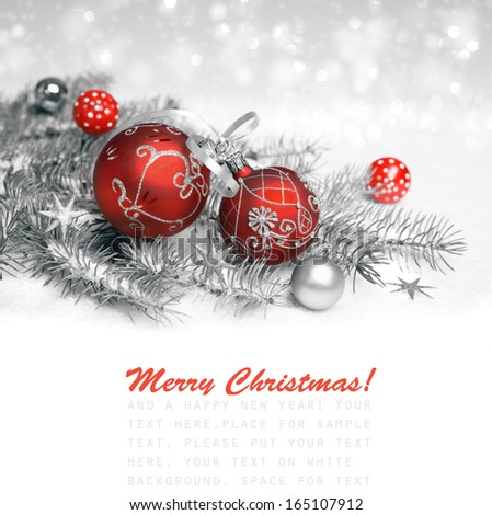 Red Christmas decorations with silver ornament on neutral winter background, text space  - stock photo