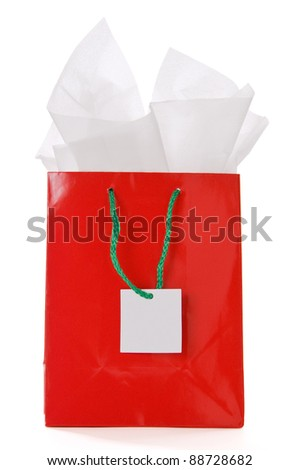 Red Christmas gift bag with blank tag isolated on a white background - stock photo