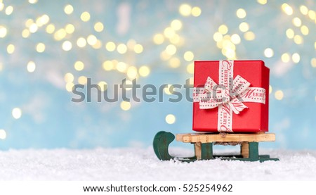 red Christmas gift box decorated on a sleigh, Christmas gift