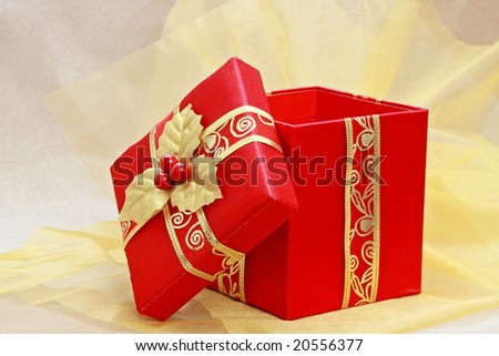 red christmas gift box on gold fabric