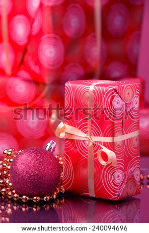 red Christmas gifts at background red ball and golden garland  - stock photo