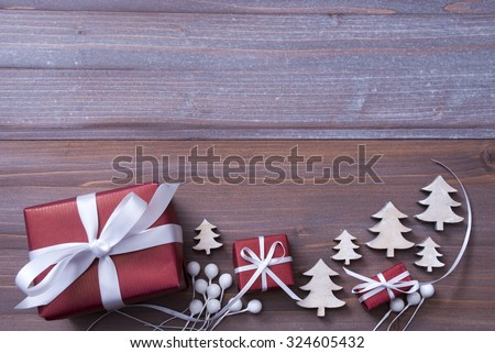Red Christmas Gifts, Presents, White Ribbon With Christmas Trees As Decoration. Rustic, Shabby Chic, Vintage Wooden Background. Copy Space For Advertisement. Card For Birthday Greetings - stock photo