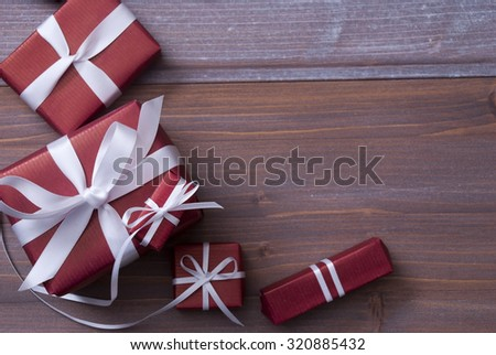 Red Christmas Gifts, Presents With White Ribbon As Decoration. Shabby Chic, Rustic, Vintage Wooden Background. Copy Space For Advertisement. Card For Seasosns Or Birthday Greetings - stock photo