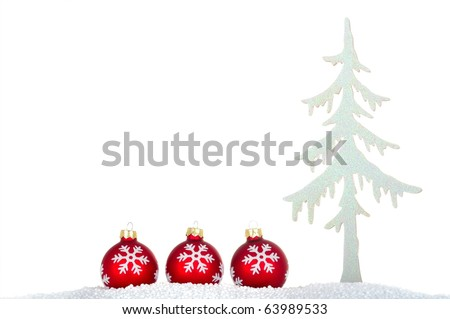 Red christmas glitter balls in snow and sparkling christmas tree isolated over white - stock photo