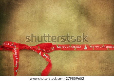 Red christmas ribbon  on  board with copy space - stock photo