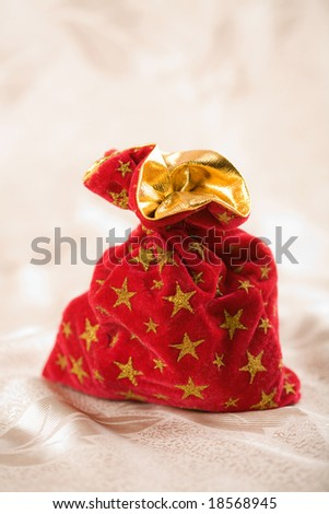 red christmas sack full of presents - stock photo