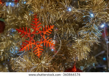 Red christmas snowflake decoration hanging - stock photo