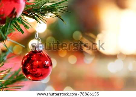Red Christmas Tree bauble by the fireplace - stock photo