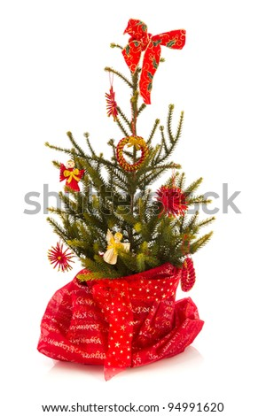 Red Christmas tree isolated over white background