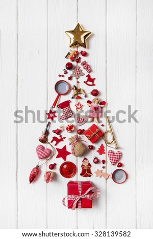 Red Christmas tree of a collection of small pieces for decoration. - stock photo