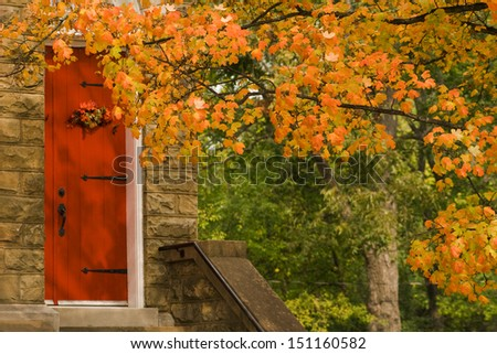 Red Church Door and Fall Tree Leaves /Red Church Door and Fall Tree Leaves /Red Church Door and Fall Tree Leaves  - stock photo