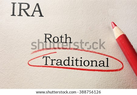Red circle and pencil with Roth and Traditional IRA text                                - stock photo