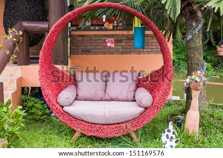 red circle bench with sofa on green grass, relax