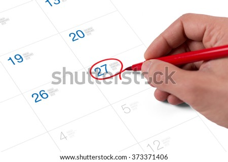 Red circle. Mark on the calendar at February 27, 2016 - stock photo