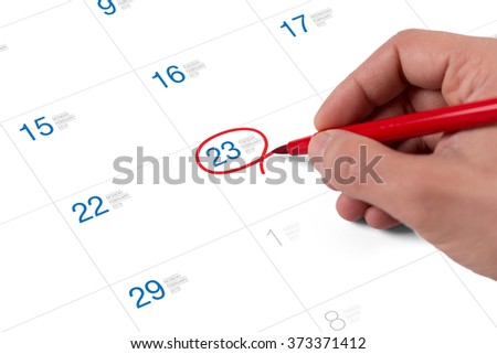 Red circle. Mark on the calendar at February 23, 2016 - stock photo