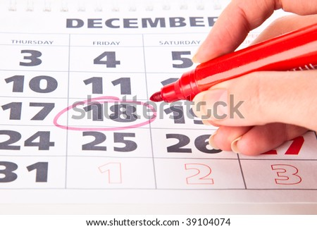 Red circle marked date on a calendar - stock photo