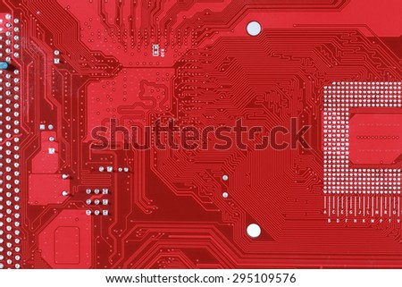 Red circuit board texture background close-up of computer motherboard