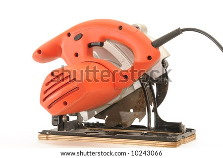 red circular saw on white background - stock photo