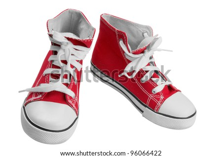 Red classic sneakers isolated over white with clipping path - stock photo