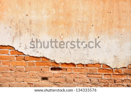 Red clay stained on the white exposed brick concrete wall. - stock photo