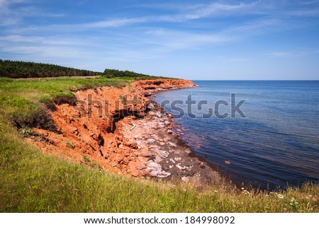Red cliffs of Prince Edward Island Atlantic coast in Green Gables Shore, PEI, Canada. - stock photo