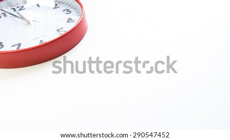 Red clocks showing last few minutes and seconds before twelve o'clock. Concept of business critical hour, deadline, danger, threat or doom. Slightly defocused and close up shot. Copy space. - stock photo