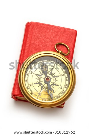 Red closed book with retro compass on it - stock photo