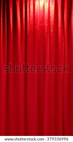 Red closed curtain background in a theater - stock photo